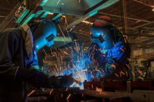 Workers are welding in factory